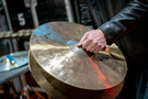 A percussionist performs on crash cymbals