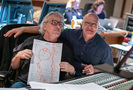 Composer Mark Mothersbaugh shows off his score artwork with scoring mixer Brad Haehnel