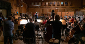 The orchestra performs on <i>Shaft</i> with composer/conductor Christopher Lennertz