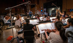 The orchestra records a cue with composer/conductor Christopher Lennertz