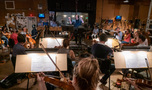 The view from the viola section as composer Christopher Lennertz conducts the orchestra