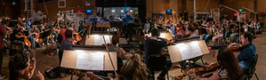 Composer Christopher Lennertz conducts the orchestra on his score for <i>Shaft</i>
