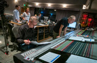 Orchestrator Andrew Kinney goes over a cue with scoring mixer Jeff Vaughn