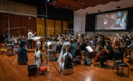 Composer/conductor Jeff Russo and the orchestra record a cue