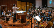 Composer/conductor Jeff Russo discusses a cue with the orchestra