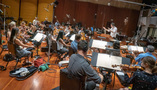 Composer/conductor Jeff Russo and the orchestra perform a cue