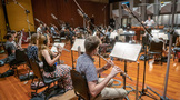 The woodwinds record a cue with the orchestra