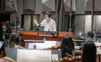 Composer/conductor Jeff Russo records a cue with the orchestra