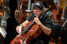 Cellist Armen Ksajikian plays his cello using paper as a bow to create an interesting effect during the score for <i>The Umbrella Academy</i>