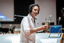 Composer/conductor Jeff Russo talks with the booth