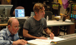 Scoring mixer Armin Steiner and composer Roger Neill listen to a cue