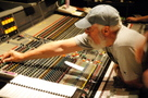 Dan Wallin makes an adjustment on the mixing board