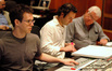 Steve Kaplan, orchestrator Brandon Roberts and mentor James Hopkins at the mixing console