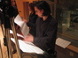 Composer Bear McCreary examines a score cue