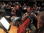 Cellist Steve Erdody explains changes to a cue to the other players