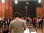 Damon Intrabartolo conducts the choir