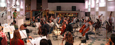 The orchestra plays on the song