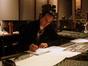 Alexandre Desplat makes notes on a cue for <i>Syriana</i>