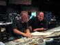 John Debney and Jon Favreau listen to a <i>Zathura</i> cue