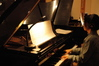 Gloria Cheng plays one of the four pianos