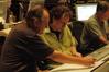 Orchestrator Conrad Pope discusses a cue with composer Mark Isham