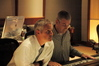 Composer Blake Neely listens to a cue playback as Recording Engineer Jeff Biggers makes adjustments