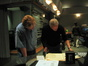 Pete Anthony and James Newton Howard examine a cue
