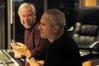 Orchestrator Brad Dechter laughs as James Newton Howard tells a joke