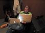 Chris Tilton works on two laptops