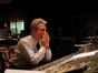 John Mauceri listens to a cue playback