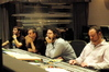 Scoring Assistant Adam Blau, orchestrator Kevin Kliesch, composer Christophe Beck and scoring mixer Casey Stone