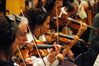 Concertmaster Endre Granat and the violin section