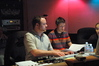Casey Stone mixes while composer Lucian Piane listens to the performance