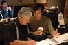 Tom Calderaro and composer Michael Andrews examine a cue