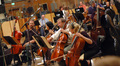 The cello section of the Hollywood Studio Symphony