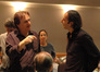 Cellist Andrew Shulman discusses a cue with Alexandre Desplat