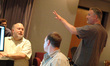 Director David Fincher talks with music editor Joe Rand as Erik Swanson looks on