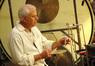 Percussionist Dan Greco plays triangle