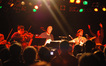 Anna Stafford, Paul Cartwright, Steve Bartek, and Brendan McCreary play hard-driving rock under the direction of Bear McCreary (r).