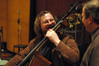 Bassist Mike Valerio laughs with contractor Peter Rotter