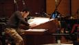 Composer/conductor Michael J. Lloyd reviews a score during a break