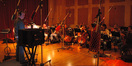 Blake Neely conducts a string ensemble of the Hollywood Studio Symphony