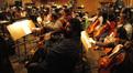 Cellist Armen Ksajikian shows his cello cozie some love