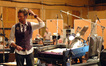 Composer Brian Tyler talks with the booth