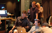 Composer Brian Tyler, music editor Joe Lisanti, contractor Sandra Kipp and director D.J. Caruso look at a video on the laptop