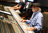 Scoring mixer Dan Wallin listens to a cue