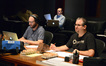 Music editor Paul Apelgren, music librarian Marshall Bowen (rear), and composer Chris Tilton listen from the booth