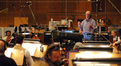 George Del Barrio discusses the cue with the orchestra