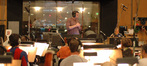 Composer Aaron Zigman conducts the orchestra