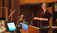 Jennifer Hammond conducts the orchestra, with Chuck Berghofer on upright bass in background